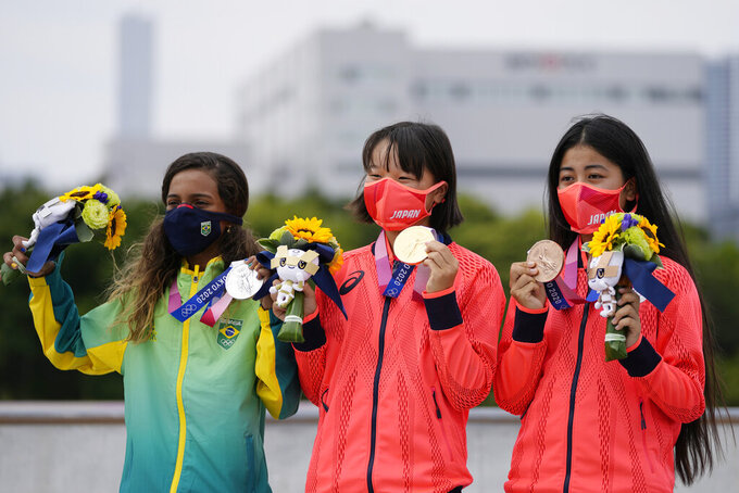From left, silver medalist Rayssa Leal of Brazil, gold medalist Momiji Nishiya of Japan, center, and bronze medalist Funa Nakayama of Japan show their medals won in the women's street skateboarding finals at the 2020 Summer Olympics, Monday, July 26, 2021, in Tokyo, Japan. (AP Photo/Ben Curtis)