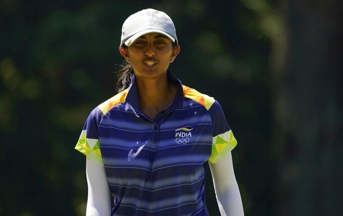 Aditi Ashok, of India, gestures on the 5th hole during the third round of the women's golf event at the 2020 Summer Olympics, Friday, Aug. 6, 2021, at the Kasumigaseki Country Club in Kawagoe, Japan. (AP Photo/Matt York)