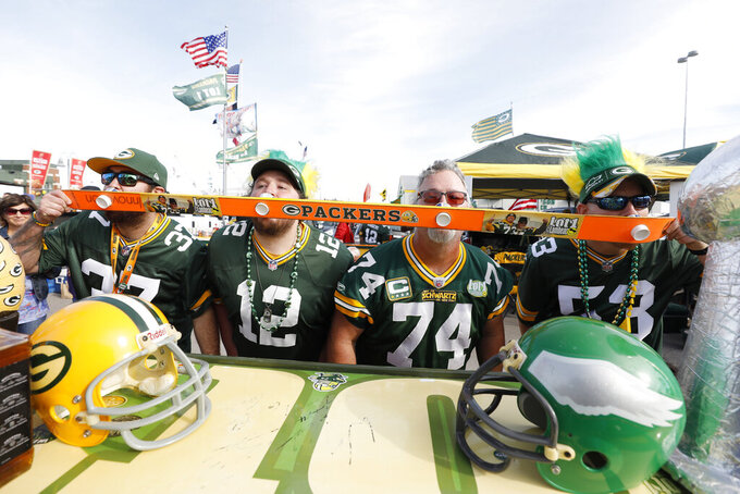 Green Bay Packers fans tailgate outside Lambeau Field before an NFL football game between Packers and the Philadelphia Eagles, Thursday, Sept. 26, 2019, in Green Bay, Wis. (AP Photo/Jeffrey Phelps)