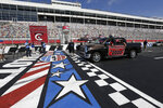 Class of 2020 graduating seniors from Cabarrus Early College of Technology drive across the start-finish line at the Charlotte Motor Speedway to receive their diplomas during a graduation event in Concord, N.C., Friday, June 12, 2020. Due to the coronavirus pandemic Cabarrus County schools participated in a first-of-its-kind commencement ceremony for it's students and family. (AP Photo/Gerry Broome)