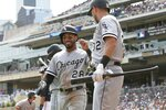 Chicago White Sox's Matt Skole, right, congratulates Leury Garcia after Garcia scored on a single by Jose Abreu off Minnesota Twins pitcher Jake Odorizzi in the first inning of a baseball game Wednesday, Aug. 21, 2019, in Minneapolis. (AP Photo/Jim Mone)