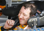 Kyle Busch adjusts his safety equipment before going out on the track during a NASCAR auto racing practice session at Daytona International Speedway, Saturday, Feb. 10, 2018, in Daytona Beach, Fla. (AP Photo/Terry Renna)