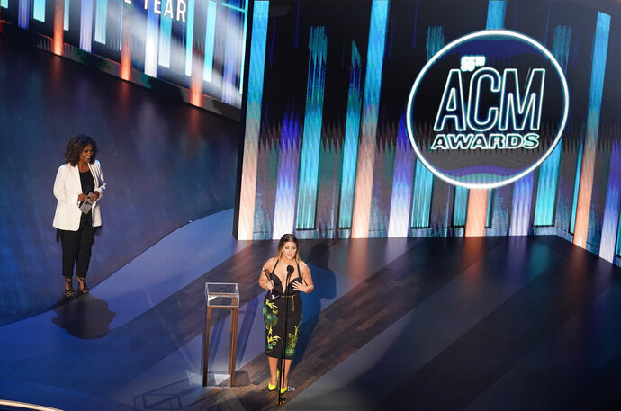 Maren Morris accepts the female artist of the year award as presenter CeCe Winans, left, looks on during the 55th annual Academy of Country Music Awards at the Grand Ole Opry House on Wednesday, Sept. 16, 2020, in Nashville, Tenn. (AP Photo/Mark Humphrey)