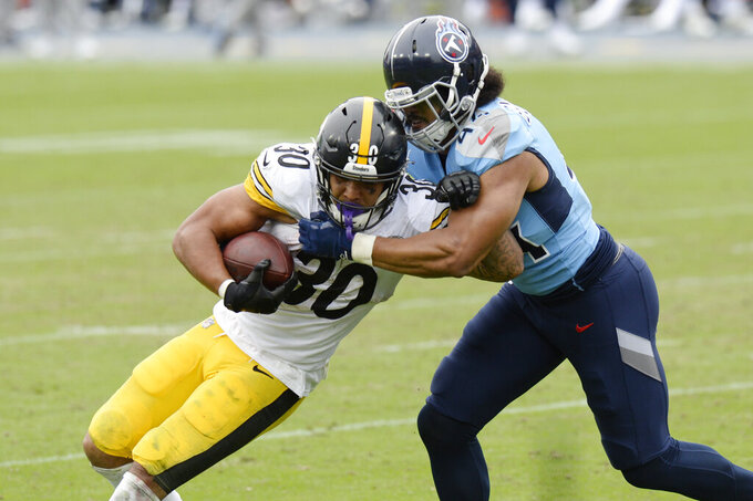 Pittsburgh Steelers running back James Conner (30) is hit by Tennessee Titans defensive end Vic Beasley (44) in the second half of an NFL football game Sunday, Oct. 25, 2020, in Nashville, Tenn. (AP Photo/Mark Zaleski)