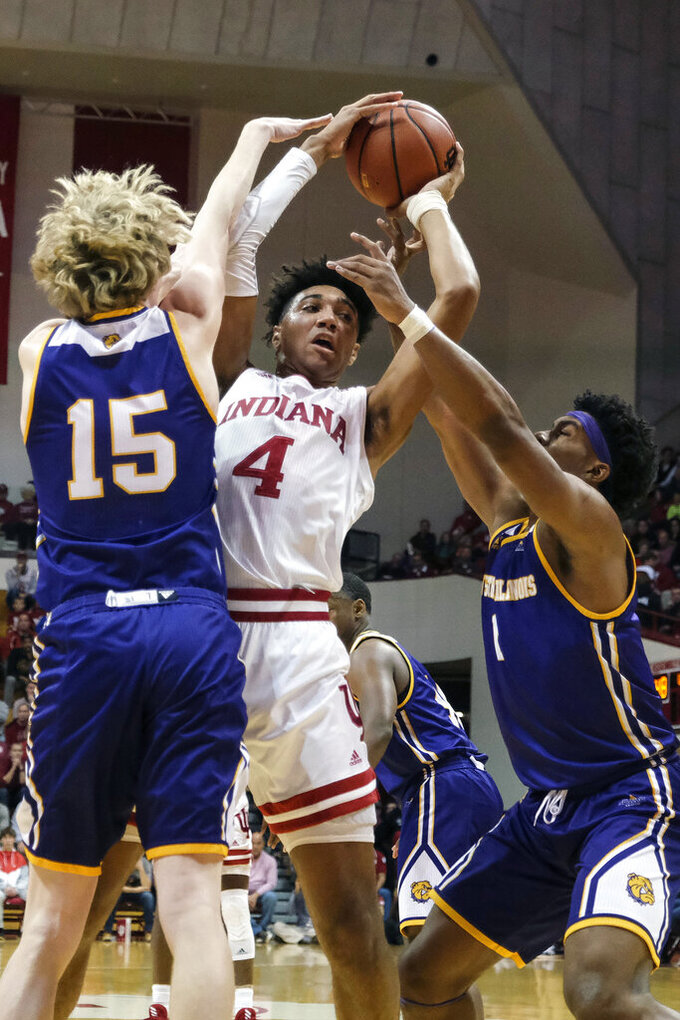 Indiana forward Trayce Jackson-Davis (4) shoots over the defense of Western Illinois forward Ben Pyle (15) and guard Zion Young (1) in the first half of an NCAA college basketball game in Bloomington, Ind., Tuesday, Nov. 5, 2019. (AP Photo/AJ Mast)
