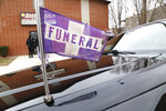 A funeral flag waves on a hearse outside a church on Chicago's West Side on Friday, April 13, 2018, during the service for 16-year-old Jaheim Wilson, who was shot and killed a few days earlier. Wilson was a cousin of Alexis Willis, who is a Peace Warrior at North Lawndale College Prep High School. (AP Photo/Martha Irvine)