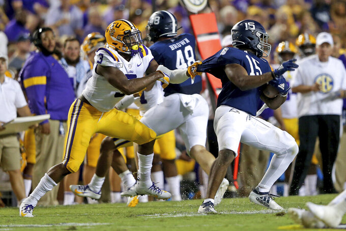 LSU safety JaCoby Stevens (3) grabs the jersey of Georgia Southern running back J.D. King (15) in the second quarter of an NCAA college football game in Baton Rouge, La., Saturday, Aug. 31, 2019. (AP Photo/Michael Democker)