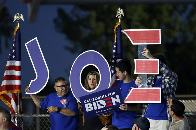 Supporters hold a sign before a campaign rally for Democratic presidential candidate former Vice President Joe Biden on Tuesday, March 3, 2020, in Los Angeles. (AP Photo/Marcio Jose Sanchez)