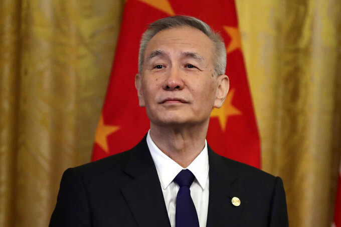 FILE - In this Jan. 15, 2020, file photo, Chinese Vice Premier Liu He listens as former President Donald Trump speaks before signing a trade agreement at the White House in Washington.  At a meeting Thursday, June 18, 2021, China pledged to harshly punish anyone responsible for major industrial accidents or outbreaks of violence in coming days as the ruling Communist Party prepares lavish celebrations for its centenary on July 1, 2021. Vice Premier Liu ordered safety checks be carried out to forestall such incidents. (AP Photo/Evan Vucci, File)