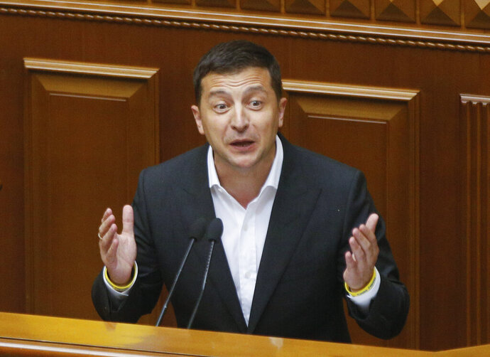 Ukrainian President Volodymyr Zelenskiy speaks to newly elected Ukrainian parliament deputies during parliament session in Kyiv, Ukraine, Thursday, Aug. 29, 2019. Parliament in Ukraine has opened for its first session since an election last month. (AP Photo/Efrem Lukatsky)