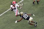 Vanderbilt cornerback Jaylen Mahoney (23) closes in on Georgia running back James Cook (4) in the first half of an NCAA college football game Saturday, Sept. 25, 2021, in Nashville, Tenn. (AP Photo/Mark Humphrey)