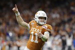 FILE - In this Tuesday, Dec. 31, 2019 file photo, Texas quarterback Sam Ehlinger celebrates a touchdown against Utah during the first half of the Alamo Bowl NCAA college football game in San Antonio. For Texas quarterback Sam Ehlinger, each day of summer workouts and training camp felt like uneasy steps toward a season that might never come. And even with his team's first kickoff coming Saturday night, Ehlinger holds his breath worrying that the coronavirus pandemic could still derail everything.  (AP Photo/Austin Gay, FIle)