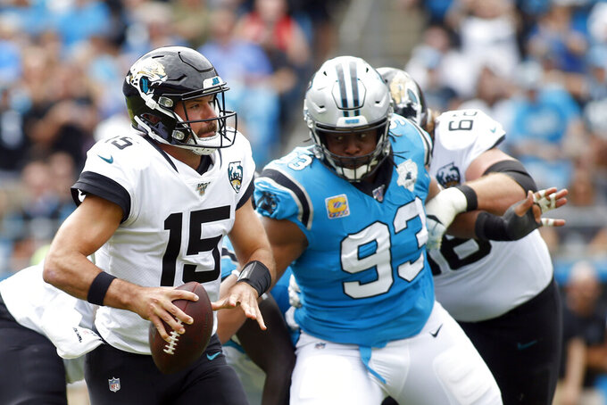 Carolina Panthers defensive tackle Gerald McCoy (93) rushes Jacksonville Jaguars quarterback Gardner Minshew (15) during the first half of an NFL football game in Charlotte, N.C., Sunday, Oct. 6, 2019. (AP Photo/Brian Blanco)
