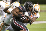 South Carolina running back Kevin Harris (20) carries against Tennessee's Kenneth George Jr. (5) and Devon Dillehay (23) during the first half of an NCAA college football game Saturday, Sept. 26, 2020, in Columbia, S.C. (AP Photo/Sean Rayford)