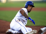 Kansas City Royals' Adalberto Mondesi steals third base during the first inning of a baseball game against the Chicago White Sox at Kauffman Stadium in Kansas City, Mo., Tuesday, July 16, 2019. Mondesi scored on the play. Chicago White Sox third baseman Yoan Moncada was charged with an error. (AP Photo/Orlin Wagner)