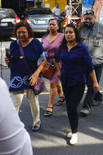 Evelyn Beatriz Hernandez, right, arrives to court for a new trial with a new judge, after her 30-year sentence for abortion was overturned in February, in Ciudad Delgado on the outskirts of San Salvador, El Salvador, Monday, July 15, 2019. The young woman who birthed a baby into a toilet in El Salvador faces a second trial for murder Monday, after having already served 33 months, in a case that has drawn international attention because of the country's highly restrictive abortion laws. (AP Photo/Salvador Melendez)