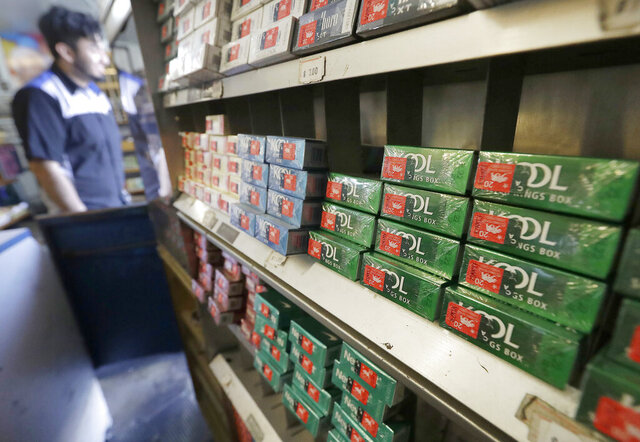 FILE - In this May 17, 2018, file photo, are packs of menthol cigarettes and other tobacco products at a store in San Francisco. California state officials have agreed to delay the effective date of what state lawmakers intended as a Jan. 1 ban on flavored tobacco products, after opponents led by tobacco companies said they filed enough signatures to put the new law to a statewide vote. (AP Photo/Jeff Chiu,File)