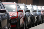 A long row of unsold 2020 Kona sports-utility vehciles sits outside a Hyundai dealership as dealers struggle to entice buyers locked down as a statewide stay-at-home order remains in effect in an effort to reduce the spread of the new coronavirus Monday, March 30, 2020, in Littleton, Colo. The new coronavirus causes mild or moderate symptoms for most people, but for some, especially older adults and people with existing health problems, it can cause more severe illness or death. (AP Photo/David Zalubowski)