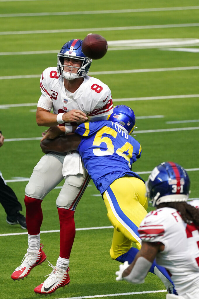 New York Giants quarterback Daniel Jones (8) throws under pressure from Los Angeles Rams outside linebacker Leonard Floyd (54) during the first half of an NFL football game Sunday, Oct. 4, 2020, in Inglewood, Calif. (AP Photo/Ashley Landis)