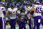 Minnesota Vikings running back Mike Boone (23) celebrates with teammates after scoring a touchdown during the second half of an NFL football game against the Los Angeles Chargers, Sunday, Dec. 15, 2019, in Carson, Calif. (AP Photo/Marcio Jose Sanchez)
