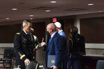 Sen. Mark Kelly, D-Ariz., speaks to Special Operations Command Gen. Richard Clarke after a hearing to examine United States Special Operations Command and United States Cyber Command in review of the Defense Authorization Request for fiscal year 2022 and the Future Years Defense Program, on Capitol Hill, Thursday, March 25, 2021, in Washington. (Anna Moneymaker/The New York Times via AP, Pool)