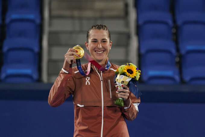Belinda Bencic, of Switzerland, poses with the gold medal in the women's singles of the tennis competition at the 2020 Summer Olympics, Sunday, Aug. 1, 2021, in Tokyo, Japan. (AP Photo/Seth Wenig)