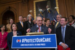 FILE - In this May 15, 2019 file photo, Senate Minority Leader Chuck Schumer, D-N.Y. , center, with House Speaker Nancy Pelosi, D-Calif., left, rallies House and Senate Democrats ahead of a House floor vote on the Health Care and Prescription Drug Package, at the Capitol in Washington. Health care is on the agenda for Congress when lawmakers return, and it's not another battle over the Obama-era Affordable Care Act. Instead of dealing with the uninsured, lawmakers are trying to bring down costs for people who already have coverage. (AP Photo/J. Scott Applewhite)