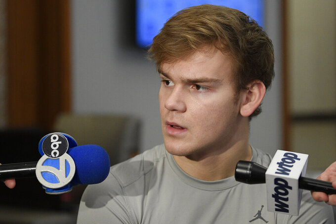 "Georgetown's Mac McClung speaks during an NCAA college basketball media availability, Wednesday, Dec. 11, 2019, in Washington.  It was hard not to do a double-take when Georgetown basketball coach Patrick Ewing replied to a question Wednesday about whether his full roster will be available for the team's next game, against Syracuse, by saying, ""As of now, yes."" That'll be the Hoyas' first home contest since legal matters involving players came to light. (AP Photo/Nick Wass)"