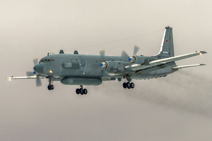In this photo taken on Saturday, March 4, 2017, a Il-20 electronic intelligence plane of the Russian air force flays near Kubinka airport, outside Moscow, Russia. An Il-20 aircraft was shot down Tuesday, Sept. 18, 2018 by a Syrian missile over the Mediterranean Sea, killing all 15 people on board, as the Syrian military fired on Israeli fighter jets attacking targets in northwestern Syria. (AP Photo/Marina Lystseva)