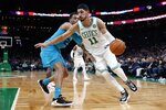 Boston Celtics' Enes Kanter (11) drives past Charlotte Hornets' PJ Washington (25) during the first half of a preseason NBA basketball game in Boston, Sunday, Oct. 6, 2019. (AP Photo/Michael Dwyer)