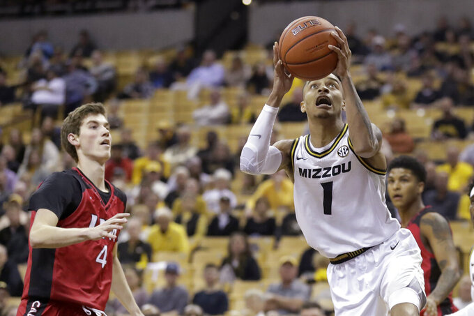 Missouri's Xavier Pinson (1) heads to the basket as Incarnate Word's Derek Van Vlerah (4) watches during the second half of an NCAA college basketball game Wednesday, Nov. 6, 2019, in Columbia, Mo. (AP Photo/Jeff Roberson)