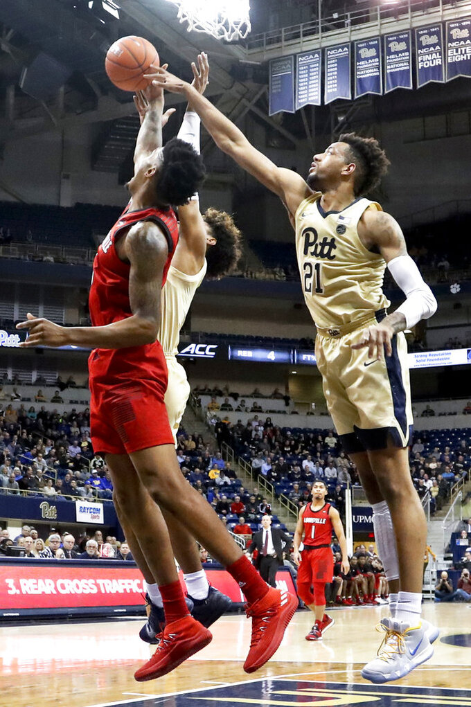 Pitt snaps long ACC losing skid, tops Louisville 89-86 in OT