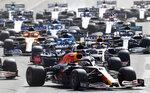 Red Bull driver Max Verstappen of the Netherlands, center, steers his car during the Formula One Grand Prix at the Baku Formula One city circuit in Baku, Azerbaijan, Sunday, June 6, 2021. (AP Photo/Darko Vojinovic)