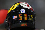 A sticker remembering the 20th anniversary of 9/11 is displayed on the helmet of Maryland defensive lineman Tommy Akingbesote during the first half of an NCAA college football game against Howard, Saturday, Sept. 11, 2021, in College Park, Md. (AP Photo/Nick Wass)