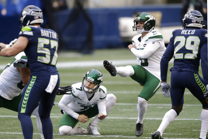 New York Jets kicker Sergio Castillo, second from right, kicks a field goal as Braden Mann (7) holds during the first half of an NFL football game against the Seattle Seahawks, Sunday, Dec. 13, 2020, in Seattle. (AP Photo/Lindsey Wasson)