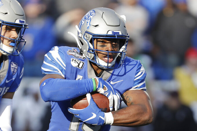 FILE - Memphis running back Kenneth Gainwell carries the ball against Cincinnati during the first half of an NCAA college football game for the American Athletic Conference championship, in Memphis, Tenn., in this Saturday, Dec. 7, 2019, file photo.  Gainwell had every intention of playing football with the Memphis Tigers last fall, going through fall practice. The funeral for an uncle, the fourth member of his family to die of COVID-19 made opting out of the season the best decision for Gainwell. (AP Photo/Mark Humphrey, File)
