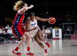 France's Valeriane Vukosavljevic (11) drives around United States' Breanna Stewart (10), left, during women's basketball preliminary round game at the 2020 Summer Olympics, Monday, Aug. 2, 2021, in Saitama, Japan. (AP Photo/Charlie Neibergall)