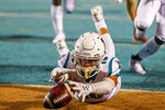 Coastal Carolina safety Alex Spillum dives on the ball in the end zone for a touchdown after he blocked a Kansas punt during the first half of an NCAA college football game in Conway, S.C., Friday, Sept. 10, 2021. (AP Photo/Nell Redmond)