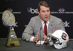 FILE - In this Dec. 13, 2018, file photo, South Carolina head coach Will Muschamp answers a question during a news conference for the Belk Bowl NCAA college football game in Charlotte, N.C. The Gamecocks host both of the participants in last year's College Football Playoff championship game: Clemson and Alabama. They also travel to Georgia, the runner-up in the national championship game two years ago. South Carolina's schedule shapes up as arguably the nation's toughest. (AP Photo/Chuck Burton, File)