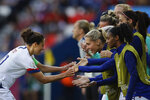 United States' Carli Lloyd, left, celebrates with teammates after scoring the opening goal during the Women's World Cup Group F soccer match between United States and Chile at Parc des Princes in Paris, France, Sunday, June 16, 2019. Lloyd scored twice in US' 3-0 victory. (AP Photo/Alessandra Tarantino)