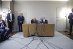 Palestinian President Mahmoud Abbas, center left, speaks while while former Israeli Prime Minister Ehud Olmert, center right, listens during a news conference in New York, Tuesday, Feb. 11, 2020. (AP Photo/Seth Wenig)
