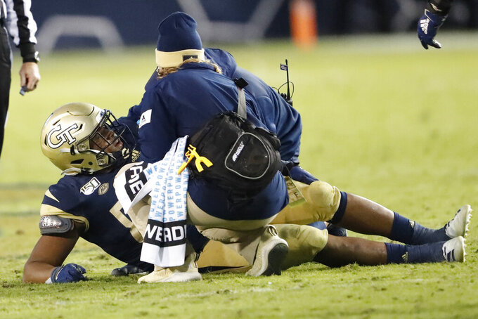 Members of the Georgia Tech training staff check on defensive lineman Antwan Owens (89) after he was injured in the second half of an NCAA college football game against the Pittsburgh Pittsburgh won 20-10. Saturday, Nov. 2, 2019, in Atlanta. (AP Photo/John Bazemore)