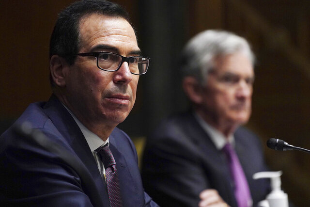 FILE - In this Sept. 24, 2020 file photo, Federal Reserve Chair Jerome Powell, right, and Treasury Secretary Steve Mnuchin testify during the Senate's Committee on Banking, Housing, and Urban Affairs hearing examining the quarterly CARES Act report to Congress on Capitol Hill, in Washington. Mnuchin on Friday, Nov. 20 denied that he is trying to limit the choices President-elect Joe Biden will have to promote an economic recovery by ending several emergency loan programs being run by the Federal Reserve. Mnuchin said his decision was based on the fact that the programs were not being heavily utilized and the money could be better used by being re-allocated by Congress to provide support in other areas such as further grants to small businesses and extended unemployment assistance.  (Toni L. Sandys/The Washington Post via AP, Pool)