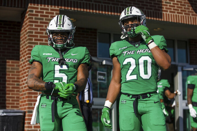Marshall running backs Sheldon Evans (5) and Brenden Knox (20) prepare to take the field for a game against UMass on Saturday, Nov. 7, 2020, at Joan C. Edwards Stadium in Huntington, W.Va. (Sholten Singer/The Herald-Dispatch via AP)