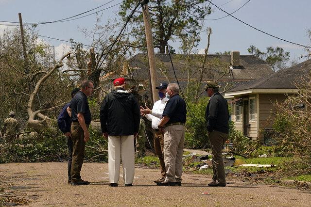 President Donald Trump tours damage from Hurricane Laura, Saturday, Aug. 29, 2020, in Lake Charles, La. (AP Photo/Alex Brandon)