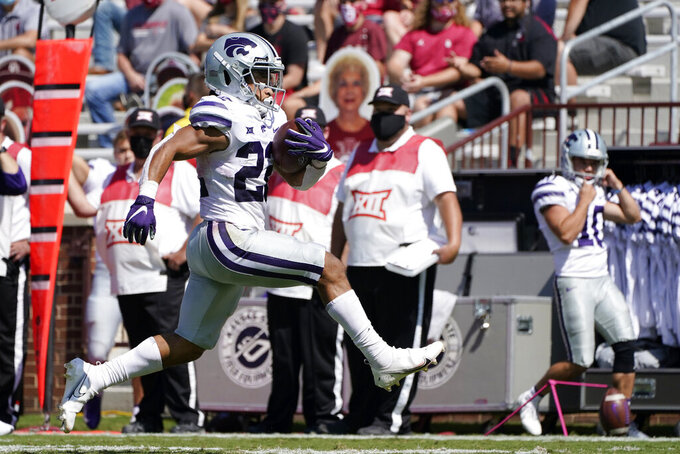 Kansas State running back Deuce Vaughn (22) carries for a touchdown against Oklahoma in the second half of an NCAA college football game Saturday, Sept. 26, 2020, in Norman, Okla. (AP Photo/Sue Ogrocki).