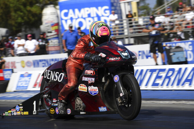 In this photo provided by the NHRA, Matt Smith drives in Pro Stock Motorcycle qualifying Saturday, July 31, 2021, at the Lucas Oil NHRA Winternationals drag races at Auto Club Raceway in Pomona, Calif. (Jerry Foss/NHRA via AP)