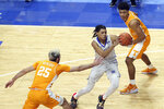 Kentucky's B.J. Boston, middle, drives between Tennessee's Jaden Springer, top, and Santiago Vescovi (25) during the second half of an NCAA college basketball game in Lexington, Ky., Saturday, Feb. 6, 2021. (AP Photo/James Crisp)
