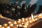 Protesters light candles at the site where student Chow Tsz-Lok fell during a recent protest in Hong Kong on Friday, Nov. 8, 2019. Chow, a Hong Kong university student who fell off a parking garage after police fired tear gas during clashes with anti-government protesters died Friday in a rare fatality after five months of unrest, fueling more outrage against authorities in the semi-autonomous Chinese territory. (AP Photo/Kin Cheung) ///