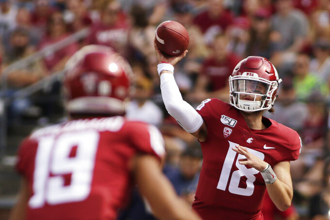 Washington State quarterback Anthony Gordon, right, throws a pass to wide receiver Brandon Arconado during the first half of an NCAA college football game against Northern Colorado in Pullman, Wash., Saturday, Sept. 7, 2019. (AP Photo/Young Kwak)